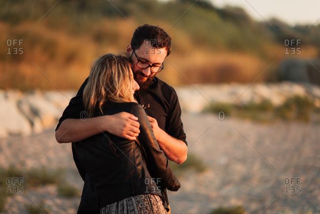 Couple in a loving hug on beach