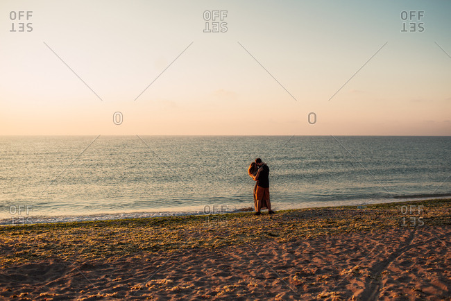 Couple on a beach in embrace