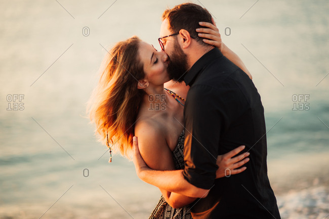 Couple in kiss on windy beach