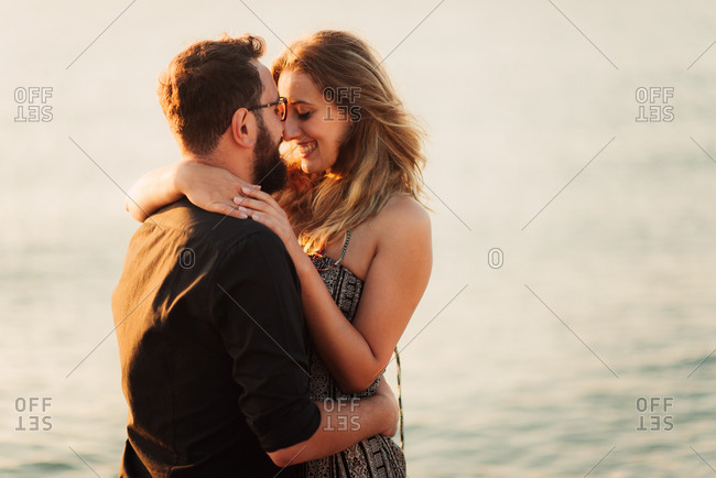 Couple in romantic embrace on beach