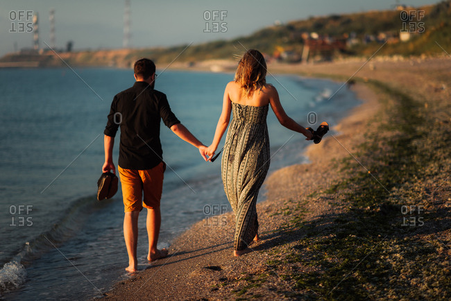 Couple in stroll on a beach