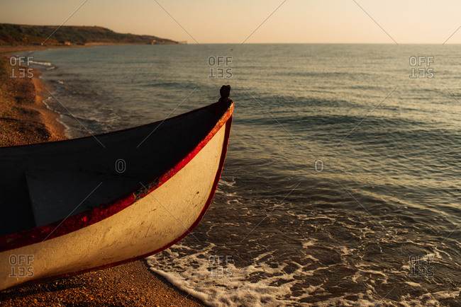 Boat by the ocean on beach