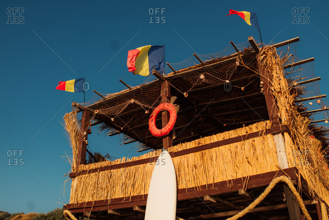Coastal structure with Romanian flags