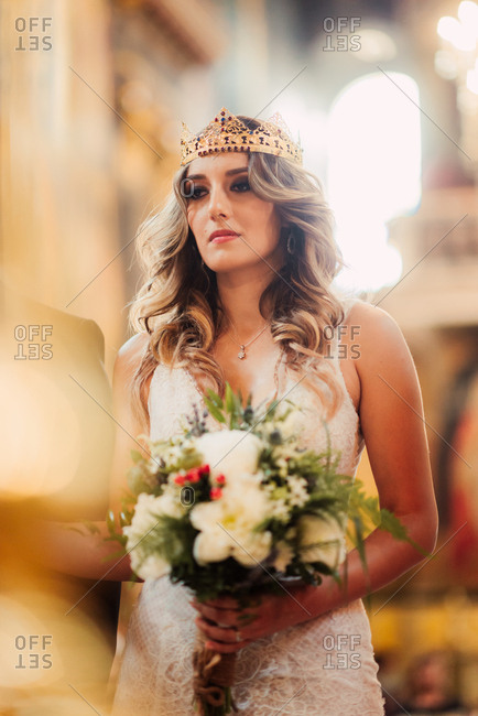 Bride wearing crown during ceremony