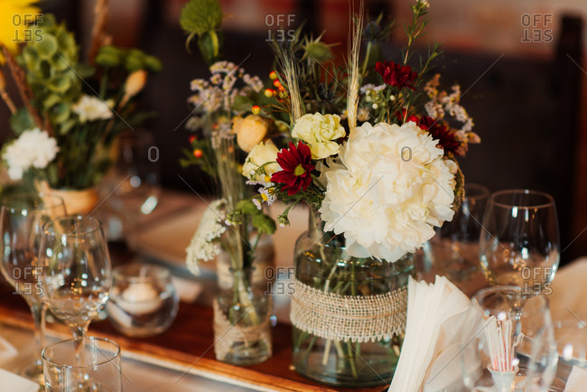 Flowers in jars on wedding table