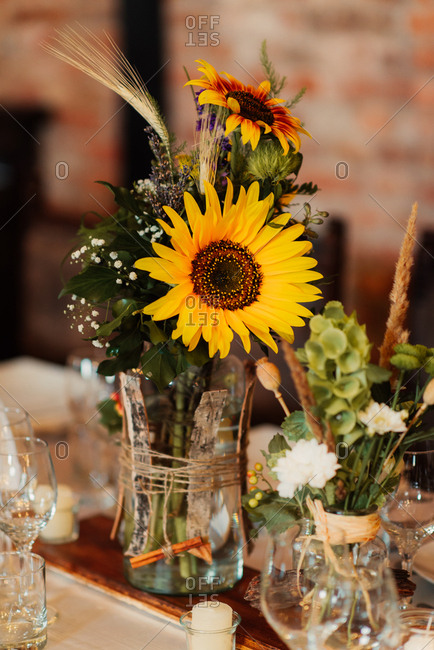 Sunflower arrangements on wedding table