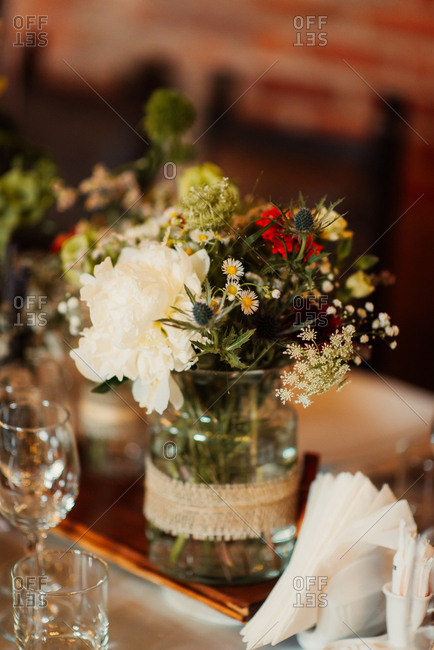 Flowers in jar on a wedding table