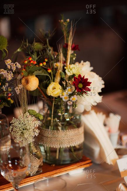 Flower arrangements on a board