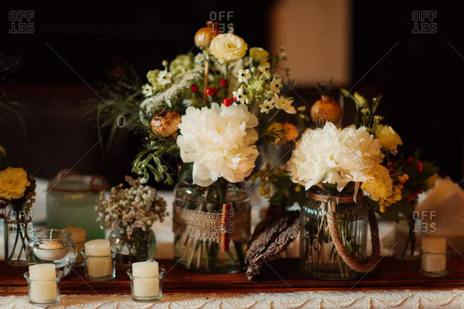 Flower arrangements with small candles
