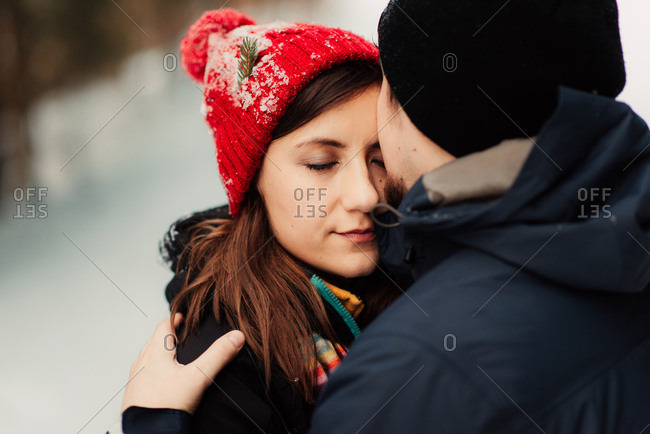 Woman kissed on the cheek by man