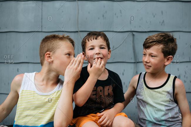 Three boys sharing secrets