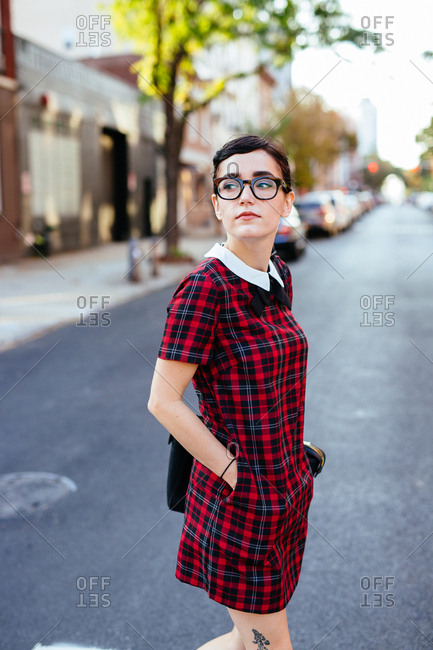 Young college student crossing the street