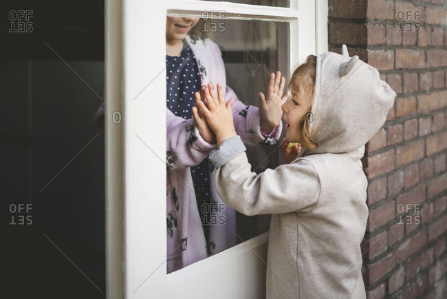 Little girls playing at door