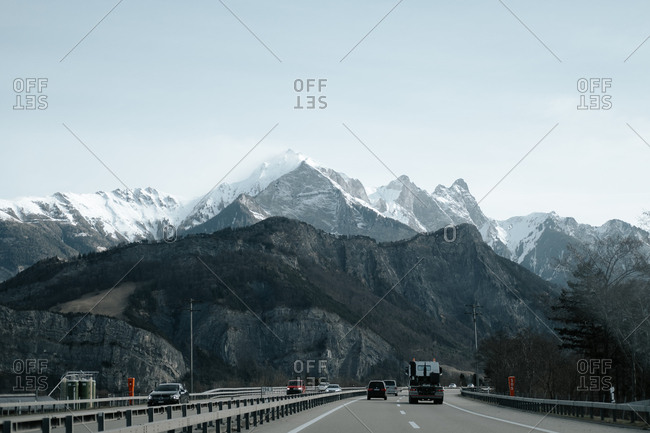 Latsch, Switzerland - March 5, 2017: Vehicles on a highway in the Swiss Alps