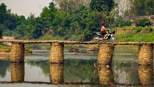 4/15/16: Motorcycle crossing a bamboo foot bridge, Luang Namtha, Laos