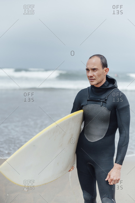 Man posing after a surfing day in Galicia, Spain