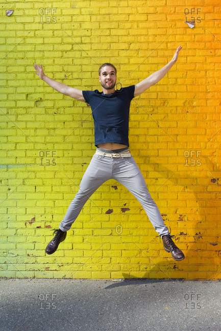 Man jumping with arms and legs out stretched