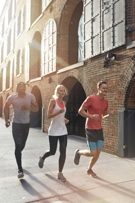 Three friends running in Brooklyn, New York City