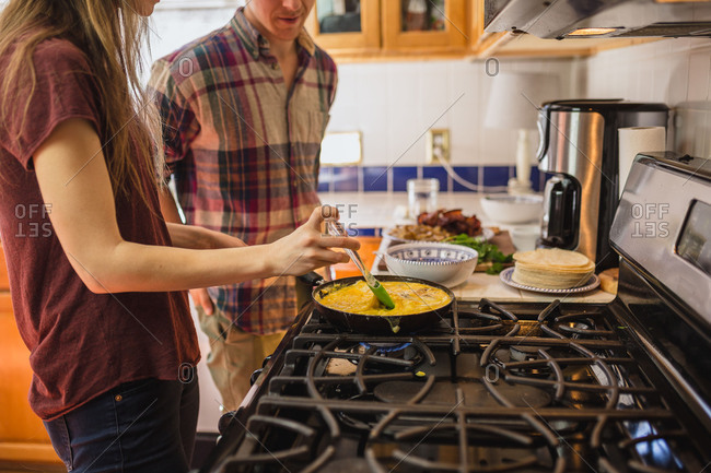 Woman stirring scrambled eggs