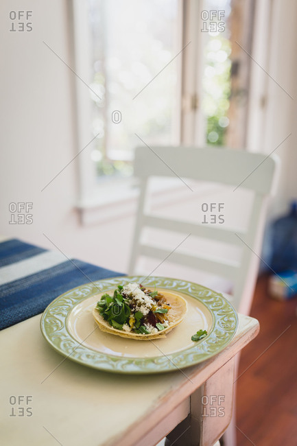 Home made breakfast taco on a kitchen table