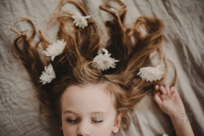 Young girl's hair decorated with white flowers