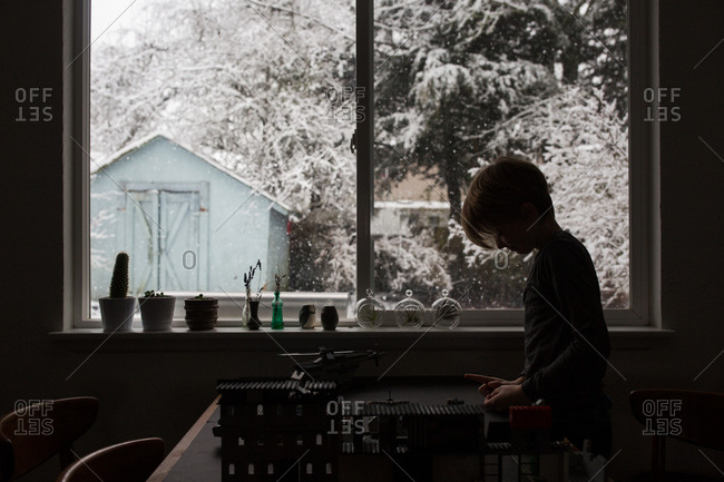 Boy playing with toys in wintertime