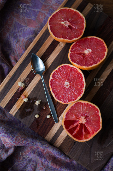 Grapefruit halves on cutting board