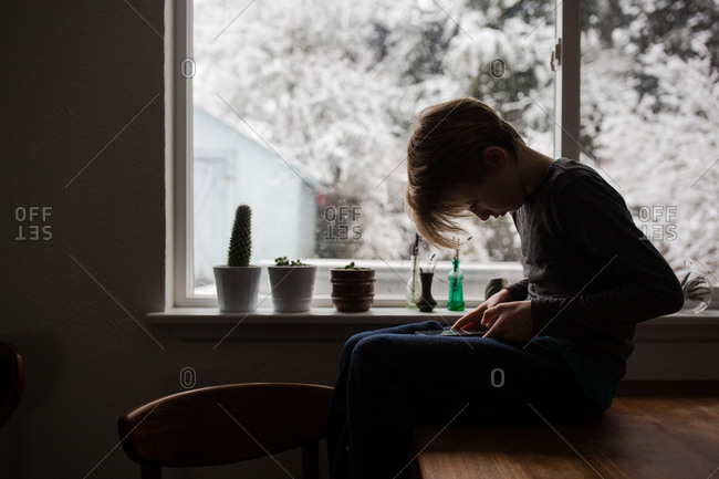 Boy using phone in wintertime