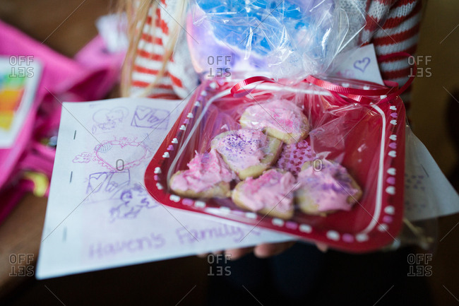 Girl with wrapped heart shaped cookies