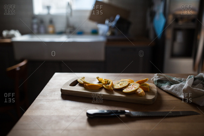 Orange peels on cutting board in kitchen