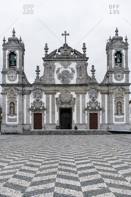 Porto, Portugal - March 2, 2017: Ornate historic church and plaza