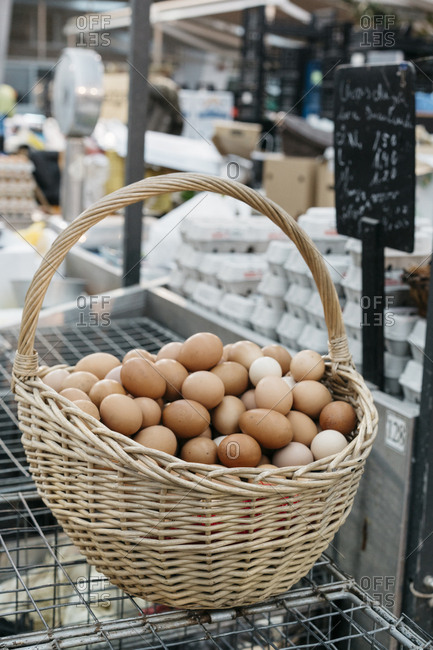 Eggs in a large wicker basket at a market