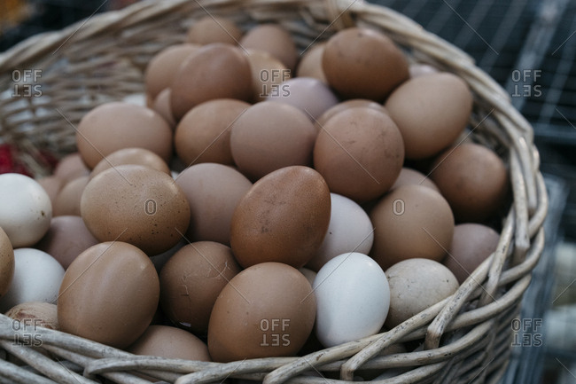 Brown eggs in a large wicker basket