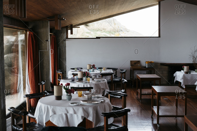 Porto, Portugal - March 3, 2017: Dining tables set for a meal at a restaurant