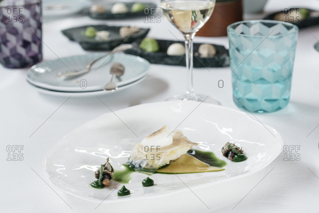 Gourmet food on a table with glasses and plates