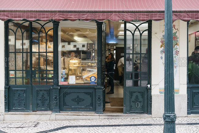 Porto, Portugal - March 5, 2017: Awning and open doors on the exterior of a bakery