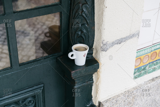 Coffee on a ledge on a storefront