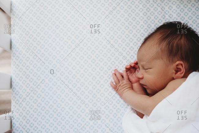 Newborn baby sleeping on his side