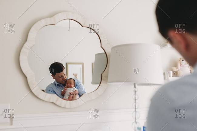Father with infant reflected in mirror