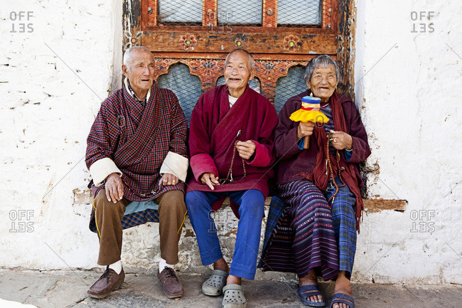 Bhutaneses sitting on a bench