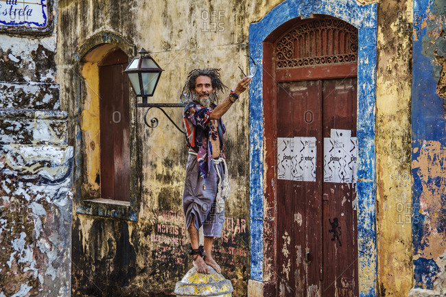 San Luis,  Brazil - August 21,  2010: A hippie in the old town