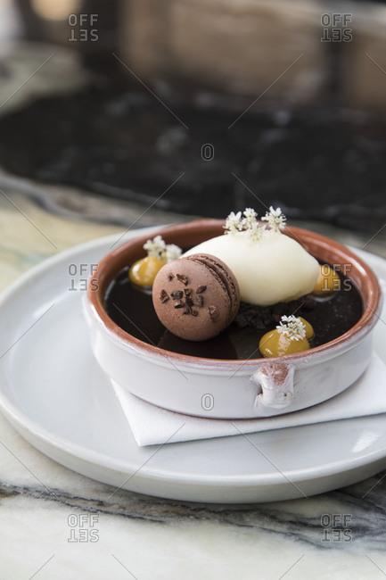 Chocolate budino dessert with macaron