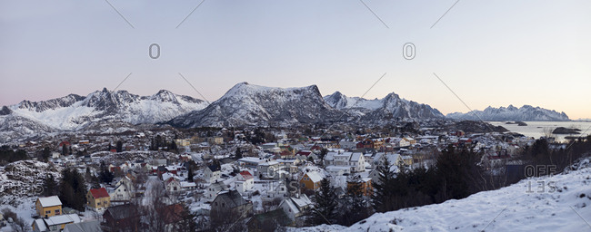 Norwegian village of Kabelvag surrounded by snowy mountains