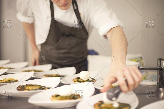 Chef preparing plates in restaurant kitchen