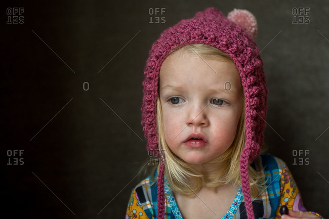 Toddler girl wearing knitted pink hat