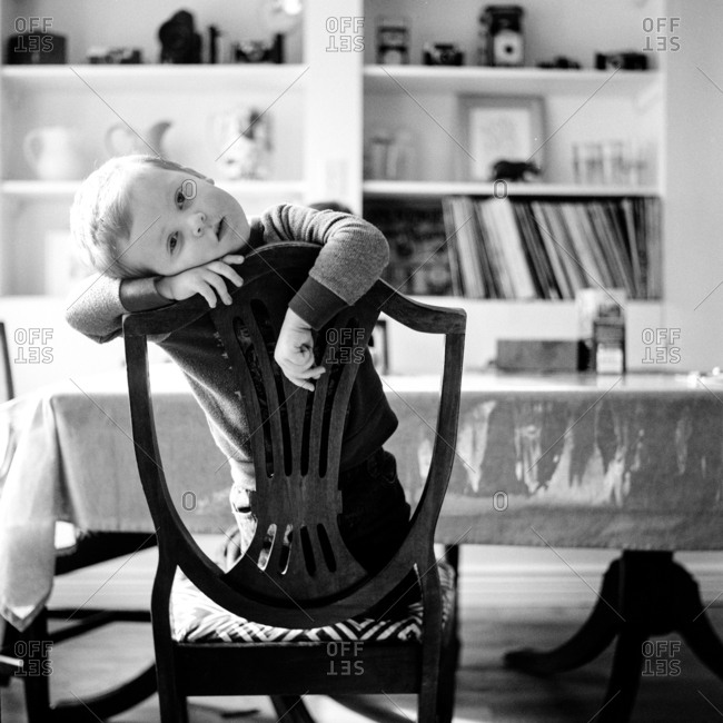 Portrait of boy in dining chair