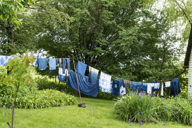 Blue dyed garments and textiles hanging on clothesline