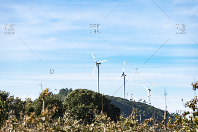 Wind generator on hillside in autumn