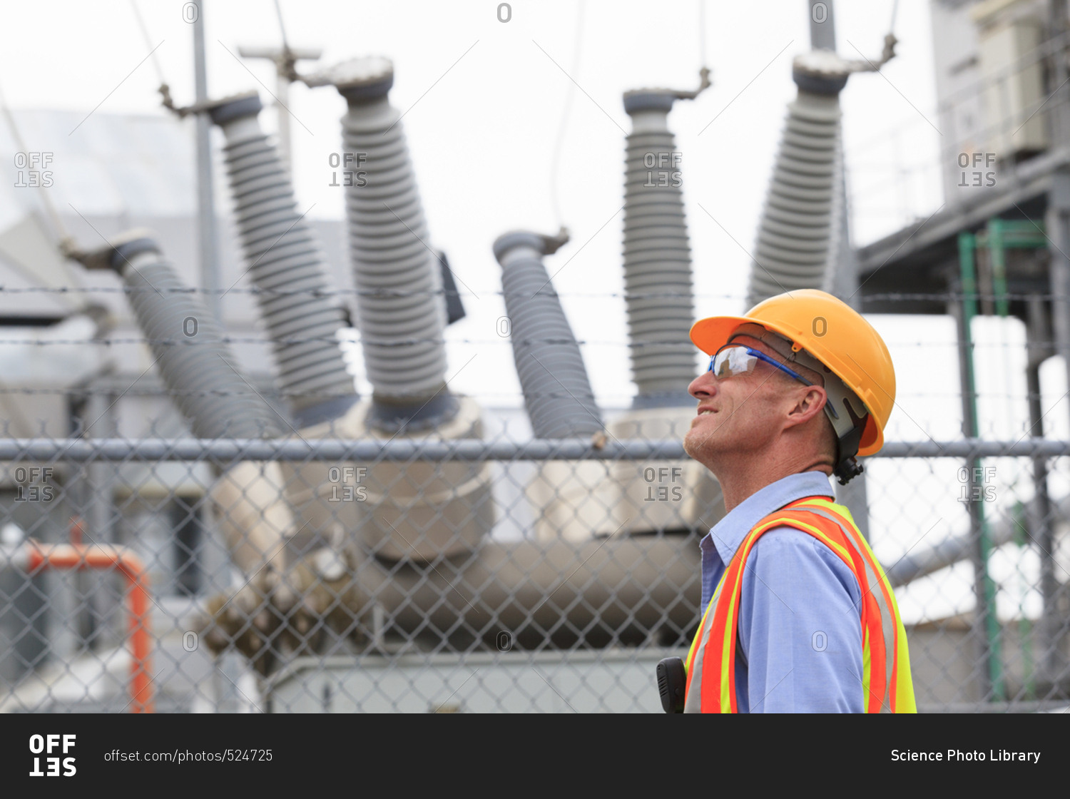 electrical engineer examining transformers inside of an electric power plant - Power Plant Engineer