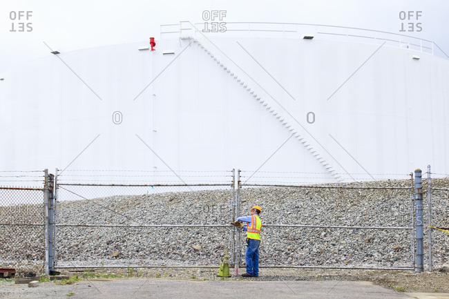 Engineer entering fuel storage tank depot